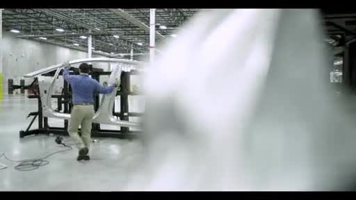 This clip shows FF 91 body-in-white factory assembly.