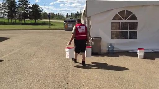 Video: Canadian Red Cross volunteers with clean-up kits during Fort McMurray re-entry following the 2016 wildfires.