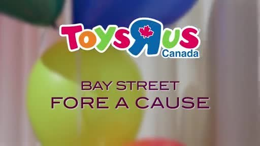 "Toys""R""Us Canada and Bay Street Fore a Cause brought Bay Street firms together to participate in a giant game of Scrabble, in Toronto, November 13, raising $70,000 in support of Childhood Cancer Canada (CNW Group/Toys ""R"" Us (Canada) Ltd.)"