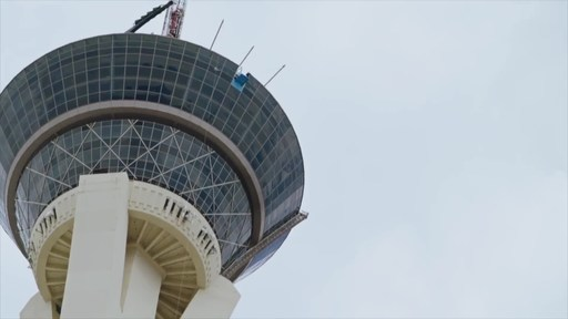 SkyJump Powered by MTN DEW at The STRAT is a heart-pounding, open-air controlled descent with speeds topping 40 mph from 855 feet above the Las Vegas Strip. The attraction holds a Guinness World Record as the highest commercial decelerator descent facility.