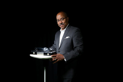 Famed auto designer Ed Welburn with the trophy he created for the North American Car of the Year awards.