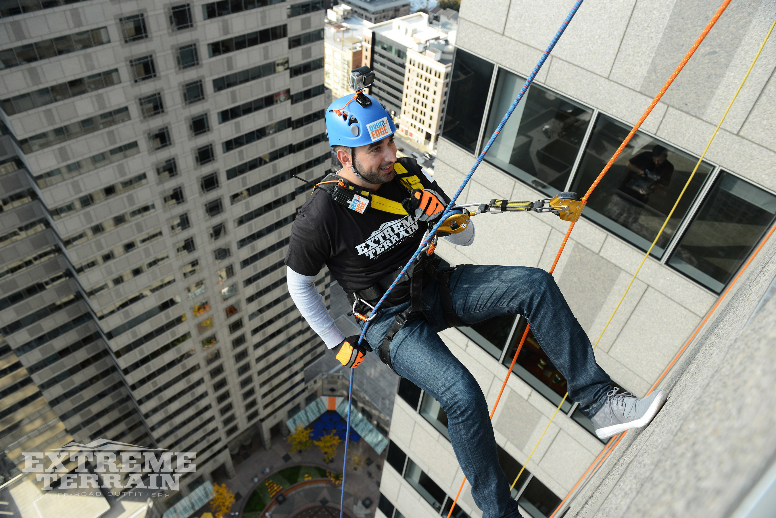 ExtremeTerrain CEO Steve Voudouris rappels down 29 stories above the Philadelphia skyline.
