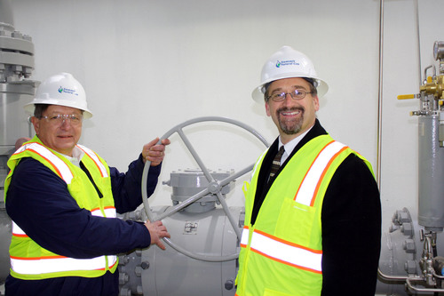 Mike Minkos, president of Summit Natural Gas of Maine and Mike Duguay, director of business development for Summit Natural Gas of Maine, at the company's tap station in Pittston. (PRNewsFoto/Summit Natural Gas of Maine, Inc.) (PRNewsFoto/SUMMIT NATURAL GAS OF MAINE, INC)