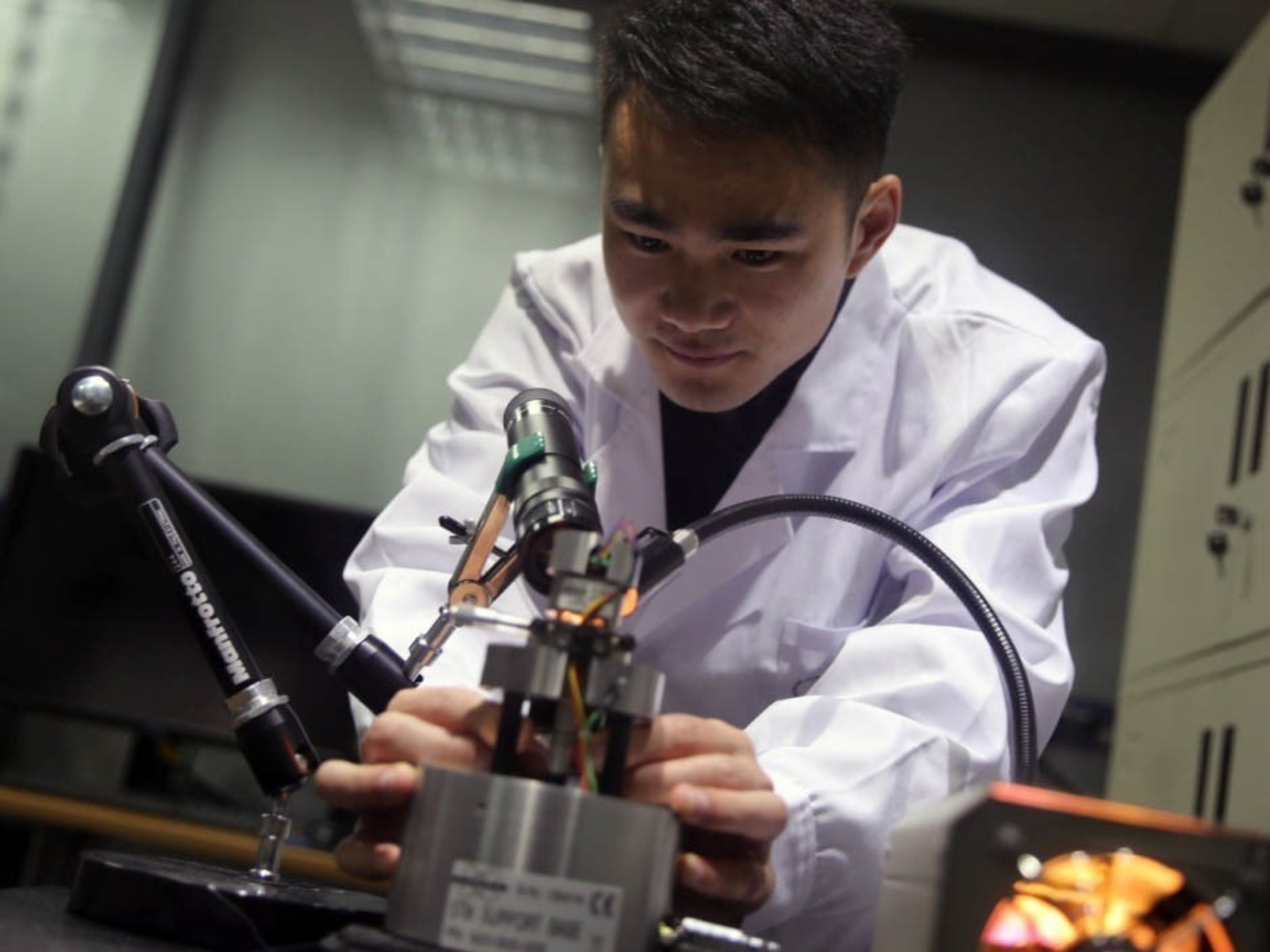 Qian Zhang, a PhD student in the Department of Chemistry at XJTLU, is researching techniques behind molecular machines.