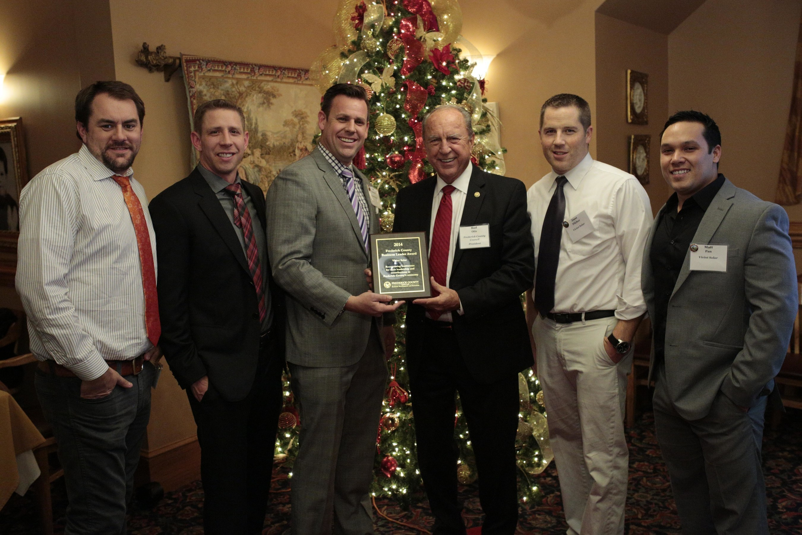 Vivint Solar District Manager Tad Thueson receives Frederick County new business award from Bud Otis, President of Frederick County Council