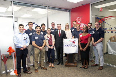 Virginia Tech President Tim Sands celebrates with students from Excella Consulting's Extension Center program at the grand opening of their new office in the Virginia Tech Corporate Research Center.