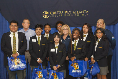 Aaron's, Inc., a leader in the sales and lease ownership and specialty retailing of furniture, consumer electronics, home appliances and accessories, has partnered with the Cristo Rey Jesuit High School Corporate Work Study Program to provide eight high school students with a work/study program during the 2016-2017 school year. (L to R): Cristo Rey students Luis Montoy, Aaron's Jeff Stine, Adrian Rodriguez, Alfonso Pena, Trish Nguyen, Kennedy Harris, Aaron's Beth Van Loon, Aliyah Crawford, Stephanie...