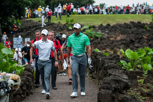 Woods and McIlroy Playing golf on volcanic lava rock at Mission Hills Haikou. (PRNewsFoto/Mission Hills China) ...