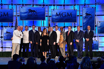 Participants and special guests at MGM National Harbor Grand Opening Press Conference (L-R): Chef Jose Andres, Maryland Senate President Mike Miller, Chef Bryan Voltaggio, CEO & Chairman of MGM Resorts International Jim Murren, County Executive Rushern Baker, Sarah Jessica Parker, Maryland Governor Larry Hogan, Chef Michael Voltaggio, Chef Marcus Samuelsson, Maryland Lottery & Gaming Control Agency Director Gordon Medenica, MGM National Harbor General Manager Bill Boasberg and MGM National Harbor President & COO Lorenzo Creighton.
