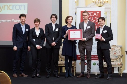 Members of the Syncron Poland team proudly accepting the Great Place To Work(R) title (PRNewsFoto/Syncron)