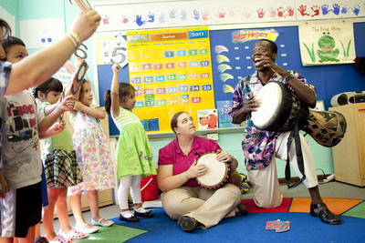 Wolf Trap Teaching Artist Kofi Dennis teaches number sequencing by way of rhythmic beats and song on a traditional African instrument, the djembe.  (PRNewsFoto/Wolf Trap Foundation for the Performing Arts)