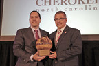 Michell Hicks, Principal Chief of the Eastern Band of Cherokee Indians (right), receives the annual national Tribal Leader of the Year award from Bill Lomax (left), president of the Native American Finance Officers Association at the NAFOA convention in Austin, TX. Hicks has lead the Eastern Band for 12 years and has been credited with significantly strengthening the Tribe's economy during his time in office. (Source: Eastern Band of Cherokee Indians)