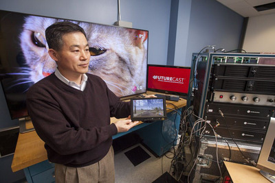 In the LG Electronics U.S. R&D lab in Lincolnshire, Ill., Dr. Jong Kim, President of LG's Zenith R&D Lab, explains the core technologies behind the FUTURECAST Universal Terrestrial Broadcasting System, the optimized combination of broadcasting capabilities for fixed, portable and mobile use.  (PRNewsFoto/LG Electronics USA, Inc.)