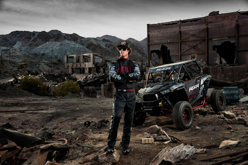 Off-road race champion and factory Polaris Pro UTV racer RJ Anderson stands with the 2014 Polaris RZR XP1K ...