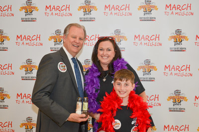 Texas Scottish Rite Hospital for Children President and CEO Robert L. Walker and Cotton Patch Cafe (Lewisville, Texas) Operating Partner Amy Masey with son, Dylan, at the restaurant company's March to a Million campaign kick-off event in March 2016. The company met its 10-year goal to donate more than $1 million to the hospital that treats children regardless of their families' ability to pay.