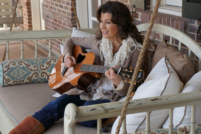 Singer-songwriter Amy Grant on her porch during filming of a new television public service announcement (PSA) with the National Association of Insurance Commissioners (NAIC).  (PRNewsFoto/National Association of Insurance Commissioners (NAIC))
