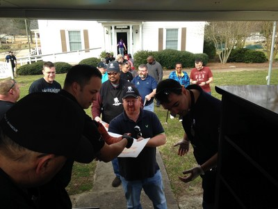 Wounded veterans learn BBQ skills during a Wounded Warrior Project event in North Carolina.