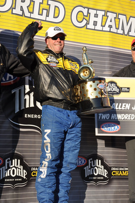 Allen Johnson, driver of the Mopar Dodge Avenger, adds to 75th anniversary celebrations for Mopar by winning the 2012 NHRA Pro Stock Championship at the season finale in Pomona, California.  (PRNewsFoto/Chrysler Group LLC)