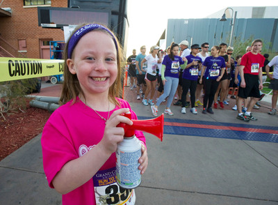 Grace Kostyk, then 6, of Phoenix, prepares to blow the horn to start the Run to Fight Children's Cancer at Grand Canyon University in March 2012. Grace was last year's Honorary Race Starter for the 10K run and 5K run/walk that raises funds for childhood cancer. This year's event is being held March 9 on the GCU campus.  (PRNewsFoto/Grand Canyon University)