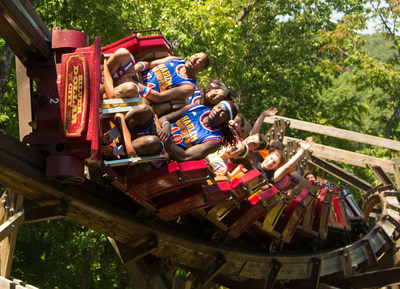 Members of the world famous Harlem Globetrotters travel through the double barrel roll of Outlaw Run, known to be the world's most daring wooden roller coaster, at Silver Dollar City Theme Park in Branson, Mo.  Silver Dollar City announced today a six-week in-residence at the park for the Globetrotters in the summer of 2015, featuring a 30-minute basketball experience performed three times daily. Silver Dollar City is an internationally awarded 1880s theme park in the famed entertainment town of Branson, Missouri. (PRNewsFoto/Silver Dollar City)