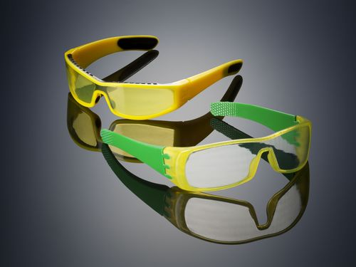 Glasses 3D printed on the Objet500 Connex3 Color Multi-material 3D Printer using Opaque VeroYellow (the frame), rubber-like black (TangoBlackPlus – also on the frame), and a unique translucent yellow tint (the lenses) in one print job – no assembly required. (PRNewsFoto/Stratasys)