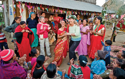 OAT travelers and locals kick up their heels in Birethanti, Nepal.  (PRNewsFoto/Overseas Adventure Travel)
