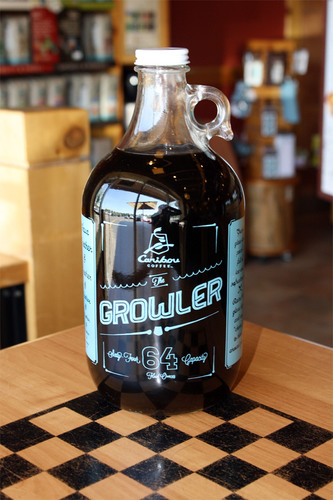 Caribou Coffee today announced the introduction of the all-new 64 oz. Caribou Growlers. Fans who purchase one can fill it up with a variety of refreshing Caribou drinks, including iced tea, still teas and juices. The Growlers are available in select Caribou retail coffeehouses today and will be rolling out to all Caribou coffeehouses by May 21.  (PRNewsFoto/Caribou Coffee Company, Inc.)