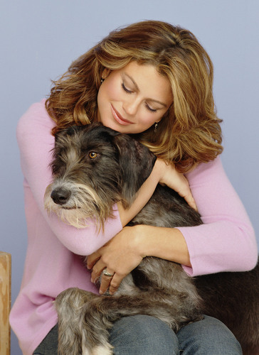 Kathy Ireland, CEO and Chief Designer for kathy ireland Worldwide (kiWW) and her dog Sparky. ...