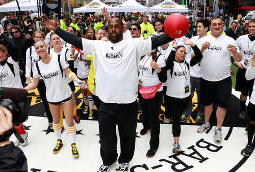 Pro football legend Donovan McNabb celebrates winning the first ever kickball game in Times Square with his ...