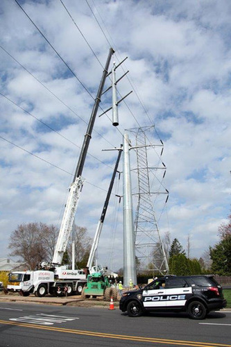 Jersey Central Power & Light recently completed the rebuild of its Whippany-Roseland 230 kilovolt transmission line. The $12 million project included replacing 19 older-style towers with new steel monopoles.  (PRNewsFoto/FirstEnergy Corp.)