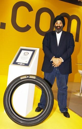 ZTyre CEO Harjeev Kandhari with the World's most Expensive Tyre (PRNewsFoto/Zenises)