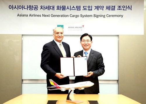Rajiv Shah, CEO, IBS Software and Kwang-Suk Kim, Executive VP, Asiana Cargo at the signing ceremony (PRNewsFoto/IBS Software (IBS))