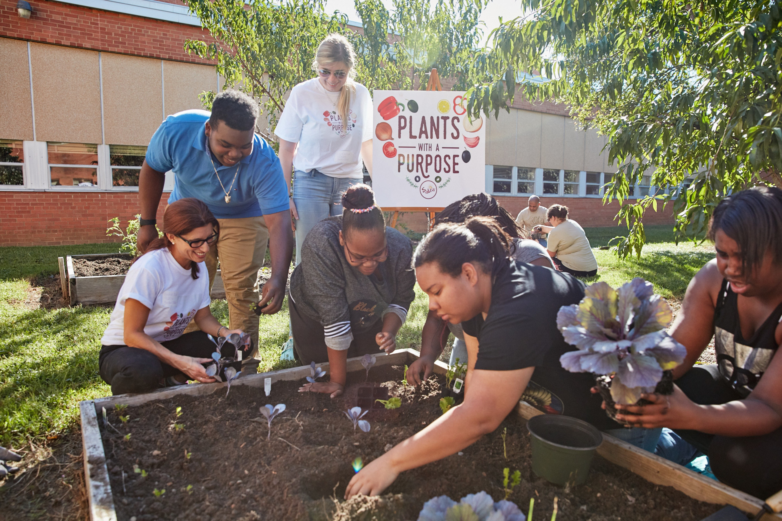Students join volunteers from Sabra and Renew Richmond to build on-site garden.