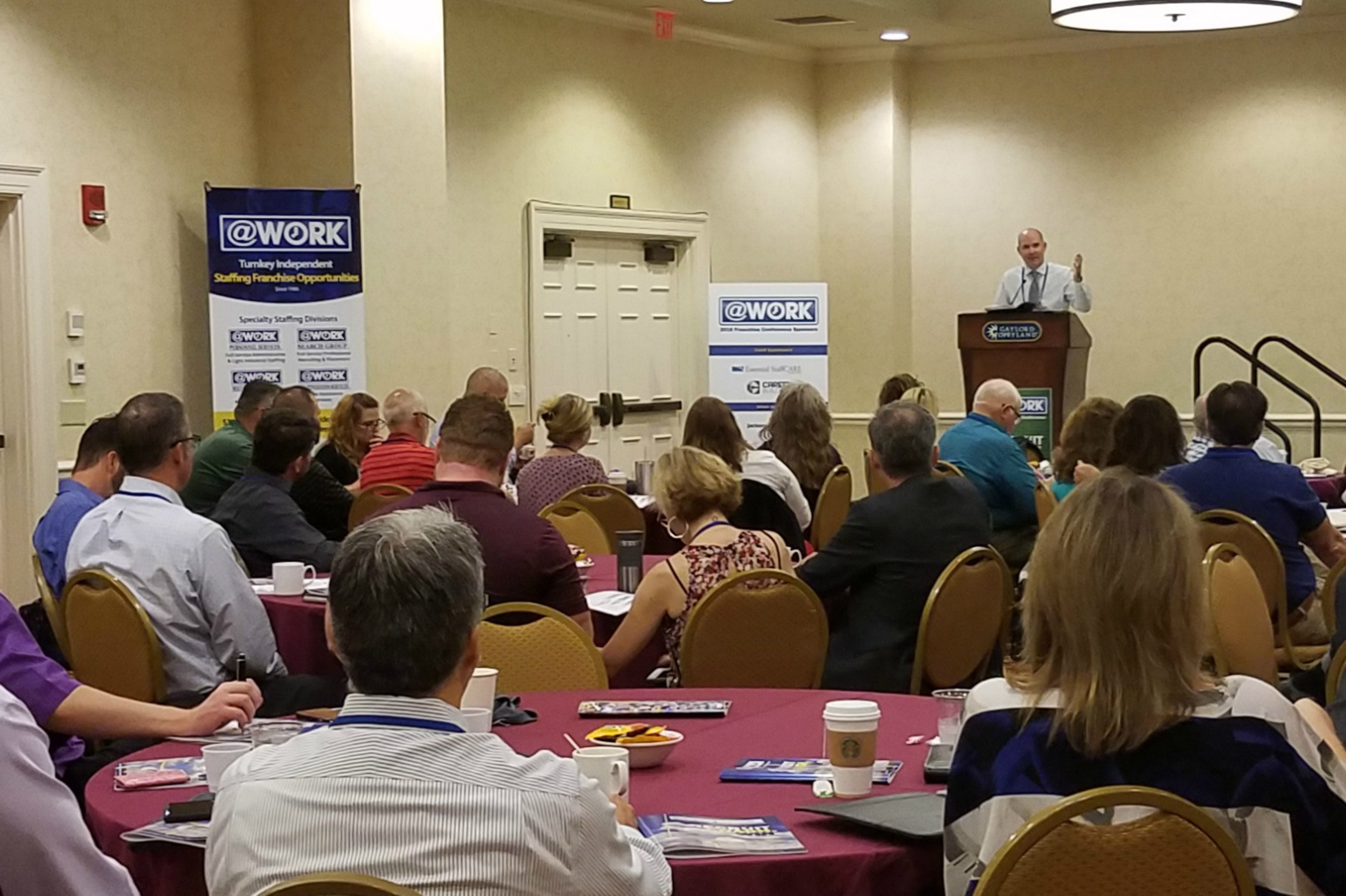 """Leverant, COO & president at AtWork Group, speaks on """"Recruit. Coach. Win."""" at the company's annual franchise convention."""
