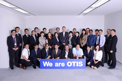 Nippon Otis Elevator Company and Schindler Elevator K.K. announced that Nippon Otis has completed the acquisition of the elevator and escalator service business of Schindler in Japan. Pictured are executives of Nippon Otis and the new Otis Elevator Service Company.