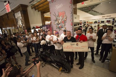 Kevin Robert Frost, CEO of amfAR, The Foundation for AIDS Research, accepts a $150,000 check from Chris Salgardo, President of Kiehl's Since 1851 during Kiehl's LifeRide for amfAR, an annual charity motorcycle ride that took place Aug. 3 through Aug. 13, 2016. Kiehl's and amfAR have announced that the $150,000 raised at this year's Kiehl's LifeRide for amfAR will go toward a specific cure-focused research project led by Satish Pillai, Ph.D., Associate Investigator at the Blood Systems Research Institute and Associate Professor of Laboratory Medicine at the University of California, San Francisco.