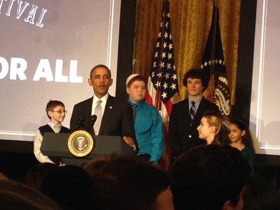 President Barack Obama speaks at the first White House Student Film Festival, Friday, Feb. 28, 2014, in the East Room at the White House in Washington. Student filmmakers pictured, Miles Pilchik, left, and Gabrielle Nafie, second right, of SciTech Kids in New York, Kids; Kyle Weintraub, second left, from David Posnack Jewish Day School in Davie, Fla.; and Shelly Ortiz, of Metropolitan Arts Institute, from Phoenix, Ariz. Photo: Beth Silver