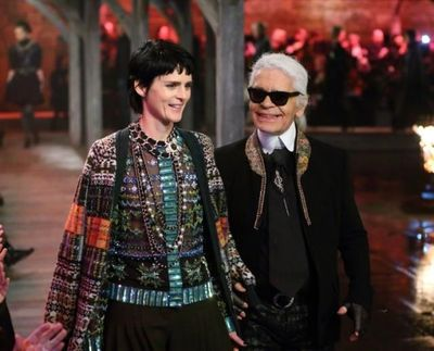 Stella Tennant and Karl Lagerfeld walk the runway at Chanel's Métiers d'Art show at Linlithgow Palace.