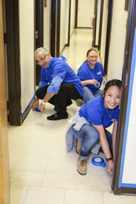 Belk associates worked on improvement projects such as painting classrooms, renovating playgrounds, building bookshelves and constructing picnic tables.