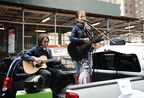 Singer Chloe Temtchine performs from the back of an Enterprise CarShare vehicle during a traveling concert series to benefit the Pulmonary Hypertension Association in New York City.