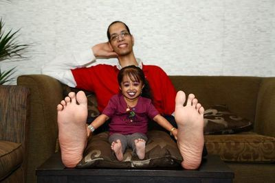 The world's shortest woman, Jyoti Amge, and second tallest man, Brahim Takioullah, (smallest feet and largest feet respectively) pose for a photo that will contribute towards a new Guinness World Records title for the Largest Online Photo Album of Feet. The mass participation challenge, titled 'Amazing Feet' has just been launched and is open to everyone.  People can take part in the record attempt by visiting officiallyamazing.tv/feet