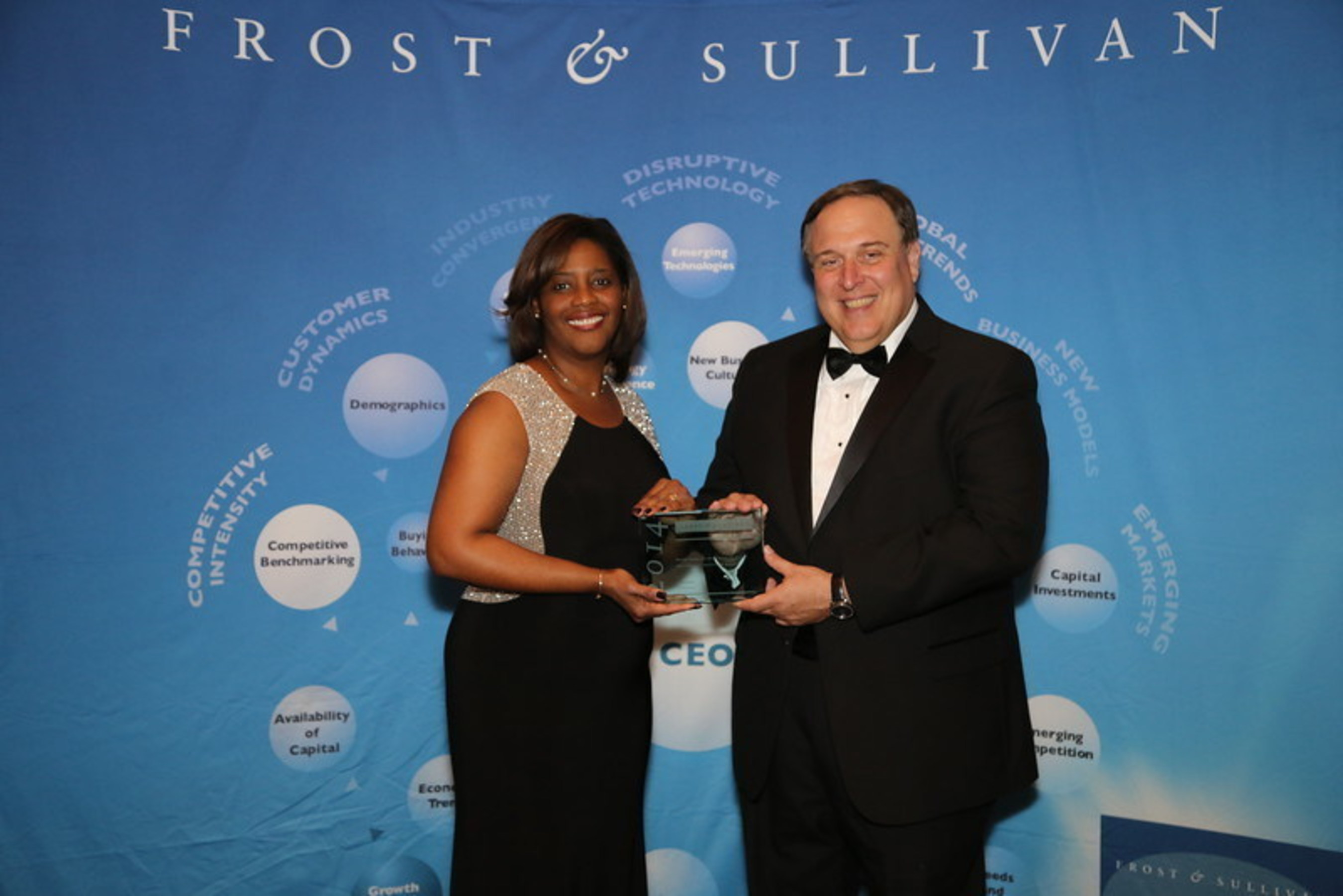 Chemetall, a business unit of Albemarle Corporation, receives prestigious Frost & Sullivan 2014 North American Metalworking Fluids New Product Innovation Award. From left to right: (Julia Murray, Vice President Global Marketing and Communications for Chemetall and Art Robbins, President - Americas and Partner, Frost & Sullivan)