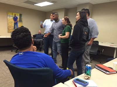 Wounded veterans learn storytelling techniques during workshop.