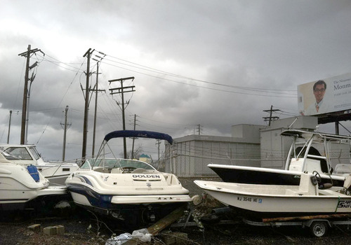 The Avalon substation in Avalon, NJ, was a parking lot for several boats deposited by Hurricane Sandy.  (PRNewsFoto/FirstEnergy Corp.)