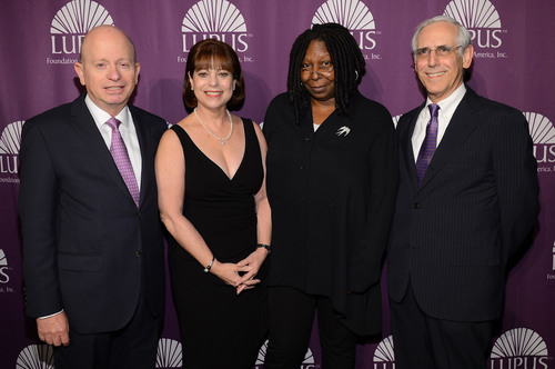 (L-R) Humanitarians Wayne and Judith Barlin, Whoopi Goldberg, and physician and renowned researcher Dr. Michael Lockshin were honored for their work to improve the lives of people with lupus, at the Lupus Foundation of America's annual Butterfly Gala in New York City on October 18.  (PRNewsFoto/Lupus Foundation of America)