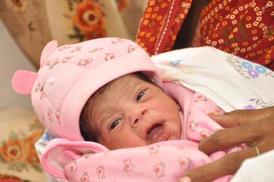 Baby 7 Billion: A milestone for girls' survival rights.  (PRNewsFoto/Plan International)