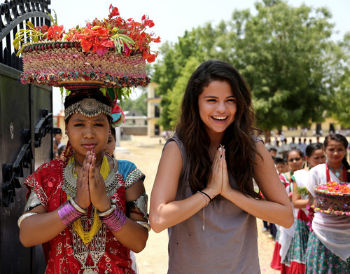 Namaste! UNICEF Ambassador, Selena Gomez is greeted by students at Satbariya Rapti Secondary School wearing traditional Nepali clothing. Photo Credit: Courtesy of U.S. Fund for UNICEF/Josh Estey/MataHati (PRNewsFoto/U.S. Fund for UNICEF, Josh Estey/MataHati)
