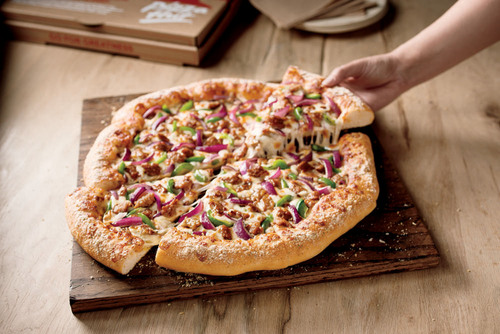 Pizza Hut(R) Launches All New Hand-Tossed Pizza Featuring A Lighter, Airier Crust. (PRNewsFoto/Pizza Hut) ...