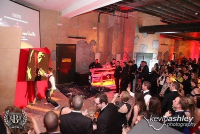 The event included Ferrari show cars from Boardwalk Ferrari, live & silent auctions, F1 simulators, ice bars, live music including DJ Eric Coomes & DJ Architekt and performance painter Mike Debus pictured here painting a masterpiece in 15 minutes!