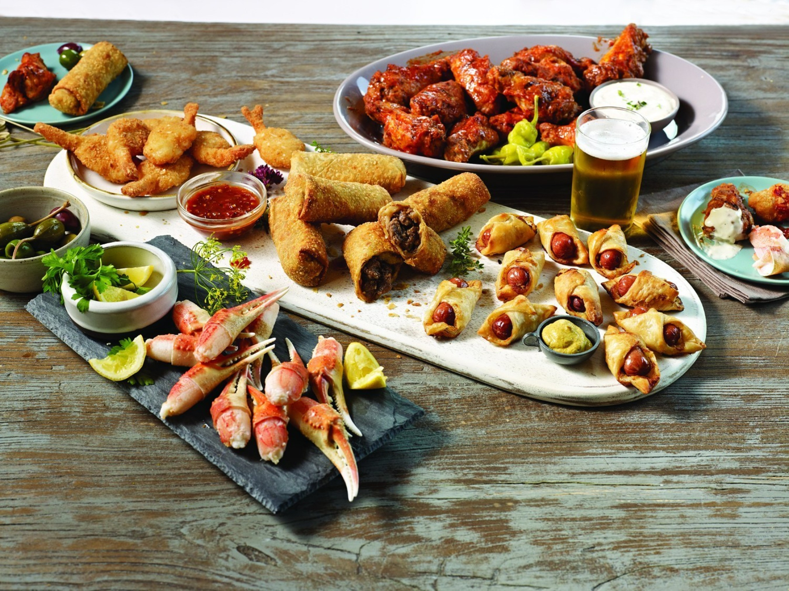 These apps from Omaha Steaks are so good, some folks might not even remember the game! This collection of gourmet favorites includes some of our finest World Port Seafood - sweet, crispy Coconut Shrimp and rich cracked Snow Crab Claws - along with plenty of our perfect Buffalo Wings and world-famous Franks in a Blanket. And, try this - the incredible, cross-cultural flavor of Omaha Steaks Filet Mignon Spring Rolls. What game?